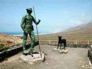 Statue av Gustav Winter og hans hund